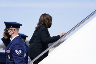Vice President Kamala Harris walks up the steps of Air Force Two at Andrews Air Force Base, Md., Friday, March 26, 2021. Harris is traveling to Connecticut to hold a listening session at the Boys & Girls Club of New Haven on how the American Rescue Plan addresses child poverty and education. (AP Photo/Susan Walsh)