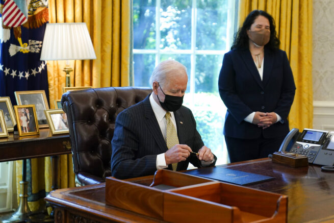Joe Biden puts a cap back on a pen after signing the PPP Extension Act of 2021, in the Oval Office of the White House, Tuesday, March 30, 2021, in Washington. Small Business Administration administrator Isabel Guzman is at right. (AP Photo/Evan Vucci)