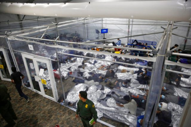 Young minors lie inside a pod at the Donna Department of Homeland Security holding facility, the main detention center for unaccompanied children in the Rio Grande Valley run by U.S. Customs and Border Protection (CBP), in Donna, Texas, Tuesday, March 30, 2021. The minors are housed by the hundreds in eight pods that are about 3,200 square feet in size. Many of the pods had more than 500 children in them. The Biden administration on Tuesday for the first time allowed journalists inside its main detention facility at the border for migrant children, revealing a severely overcrowded tent structure where more than 4,000 kids and families were crammed into pods and the youngest kept in a large play pen with mats on the floor for sleeping.(AP Photo/Dario Lopez-Mills,Pool)