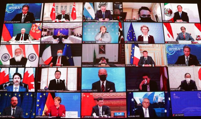 World leaders virtually attend the Leaders Summit on Climate, during the opening session, as seen on a screen at Turkey's President Recep Tayyip Erdogan's office in Ankara, Turkey, Thursday, April 22, 2021. The virtual event attended by many national leaders from their countries around the globe to raise global ambition on climate change is taking place on Earth Day, and hosted by U.S. President Joe Biden. (Mustafa Kamaci/Turkish Presidency via AP)