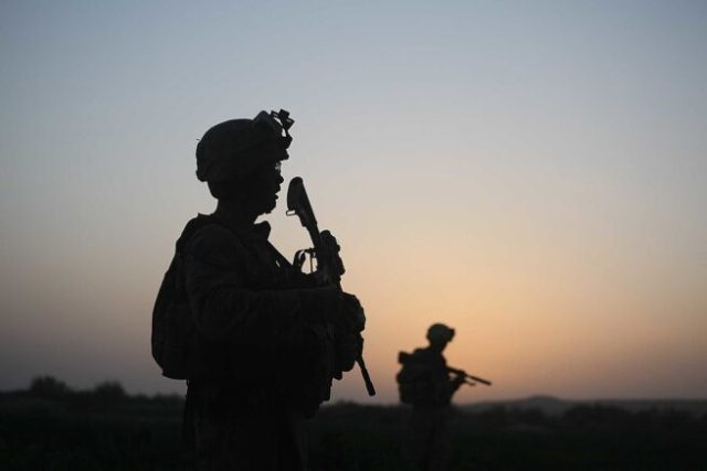 HERATI, AFGHANISTAN- JULY 18: U.S. Marines with the 2nd Marine Expeditionary Brigade, RCT 2nd Battalion 8th Marines Echo Co. step off in the early morning during an operation to push out Taliban fighters on July 18, 2009 in Herati, Afghanistan . The Marines met no resistance during the operatoin. The Marines are part of Operation Khanjari which was launched to take areas in the Southern Helmand Province that Taliban fighters are using as a resupply route and to help the local Afghan population prepare for the upcoming presidential elections. (Photo by Joe Raedle/Getty Images)