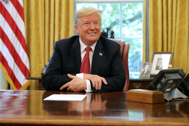 """WASHINGTON, DC - OCTOBER 17: U.S. President Donald Trump talks to reporters while hosting workers and members of his cabinet for a meeting in the Oval Office at the White House October 17, 2018 in Washington, DC. The White House said the meeting was on """"Cutting the Red Tape, Unleashing Economic Freedom."""" (Photo by Chip Somodevilla/Getty Images)"""