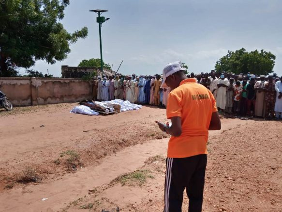 In this photo released by National Emergency Management Agency, people attend funeral of victims of a boat accident in Kebbi , Nigeria, Thursday, May 27, 2021. More than 100 people are missing and feared dead after a boat with more than 165 passengers, including women and children, broke and sank as it was traveling in Nigeria's northern Kebbi state, officials said Wednesday.(National Emergency Management Agency/via AP)