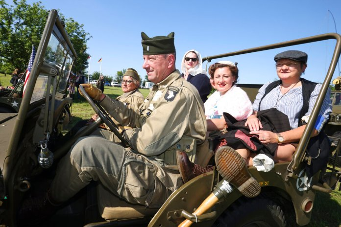 World War II history enthusiasts photographed in Normandy. (AP Photo/David Vincent)