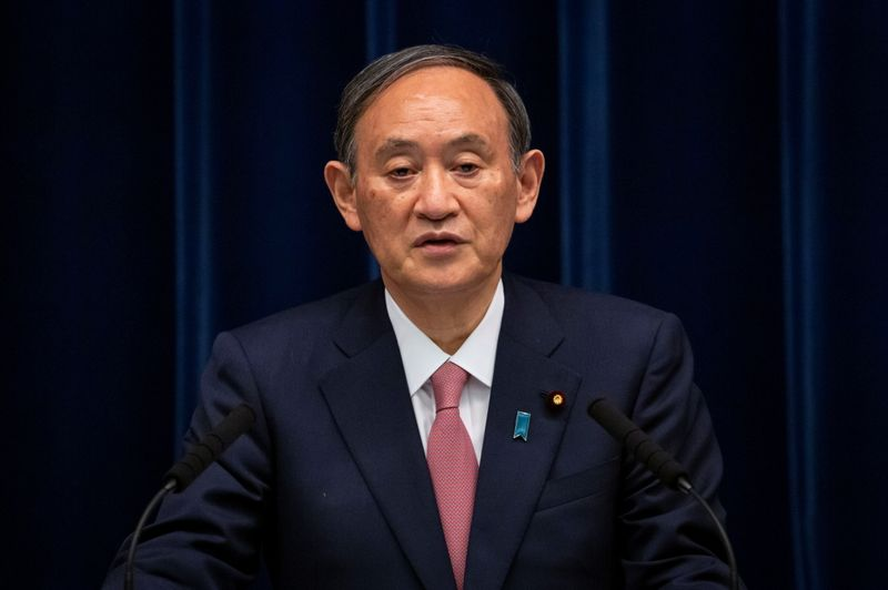 Japanese Prime Minister Suga holds a news conference, in Tokyo