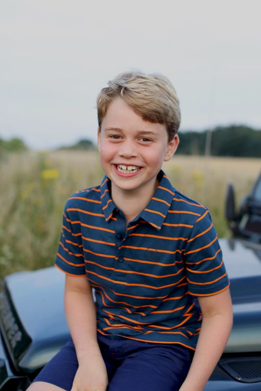 Britain's Prince George poses ahead of his eighth birthday