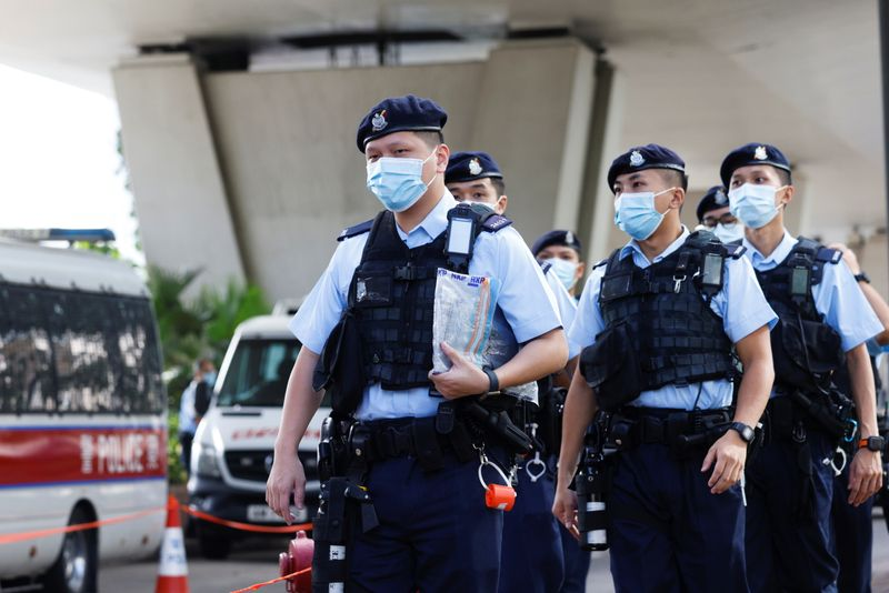 Police patrol outside the West Kowloon Magistrates' Courts building in Hong Kong