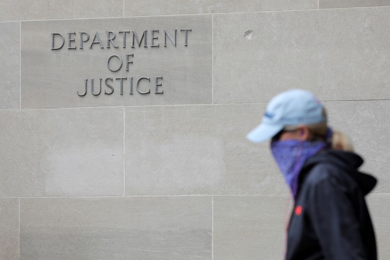 FILE PHOTO: Signage is seen at the headquarters of the United States Department of Justice (DOJ) in Washington, D.C., U.S.