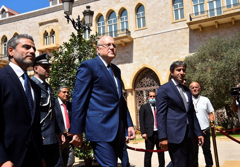 Lebanon's new Prime Minister Najib Mikati walks during an official ceremony at the Government Palace in Beirut