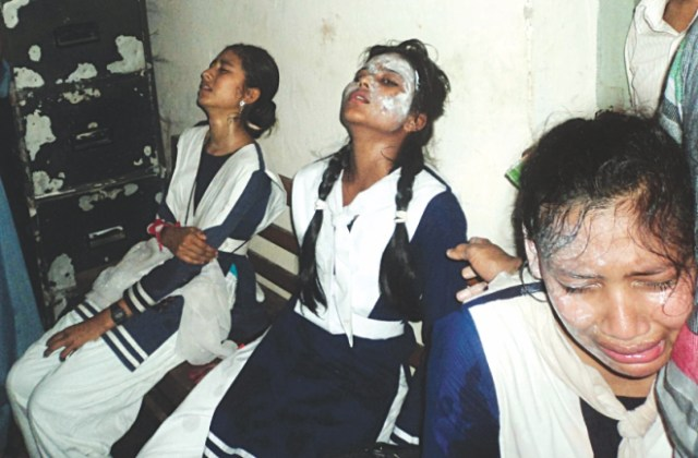 Injured school children of Joshimia Model High School of Phulbari in Kurigram where another bomb exploded when they were displaying the national flag on the school playground.