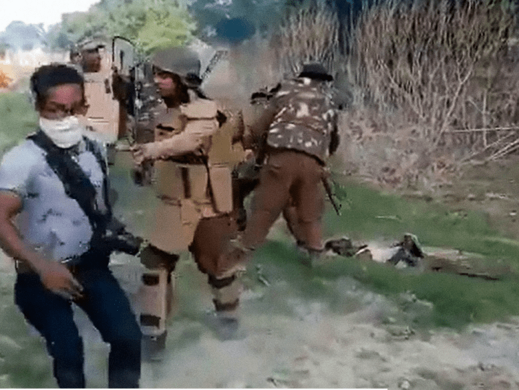 Indian Border Patrol Opens Fire on Unarmed (evicted) Assamese Protester while state Photographer Assaults Corpse