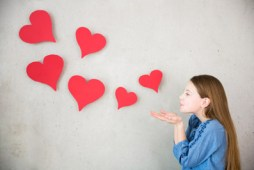 girl-blowing-paper-hearts-post