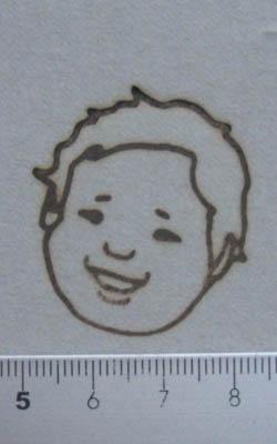 子供の顔焼印