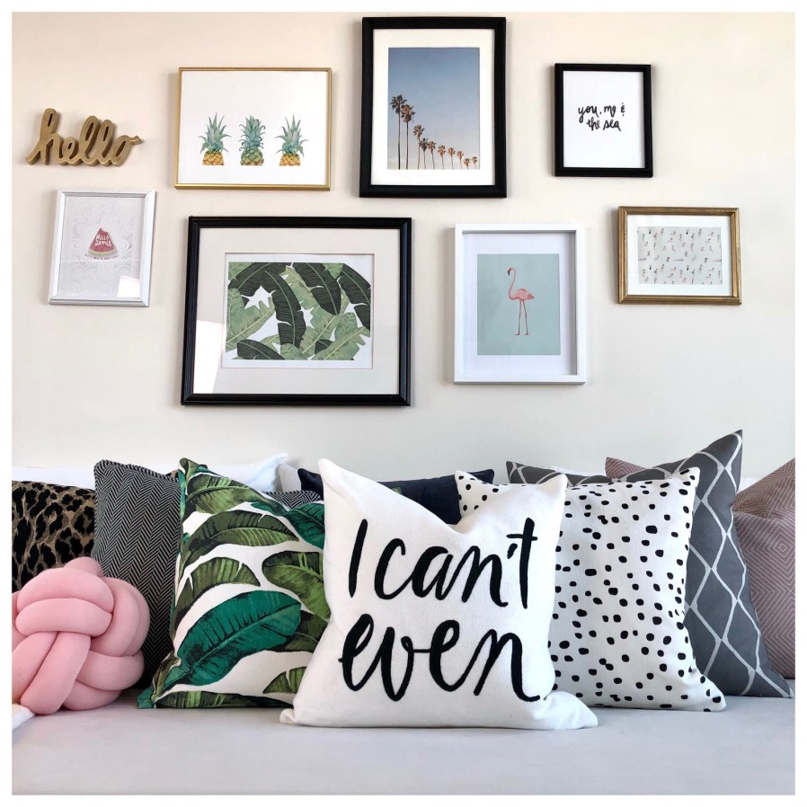 graphic pillows with framed art on the wall