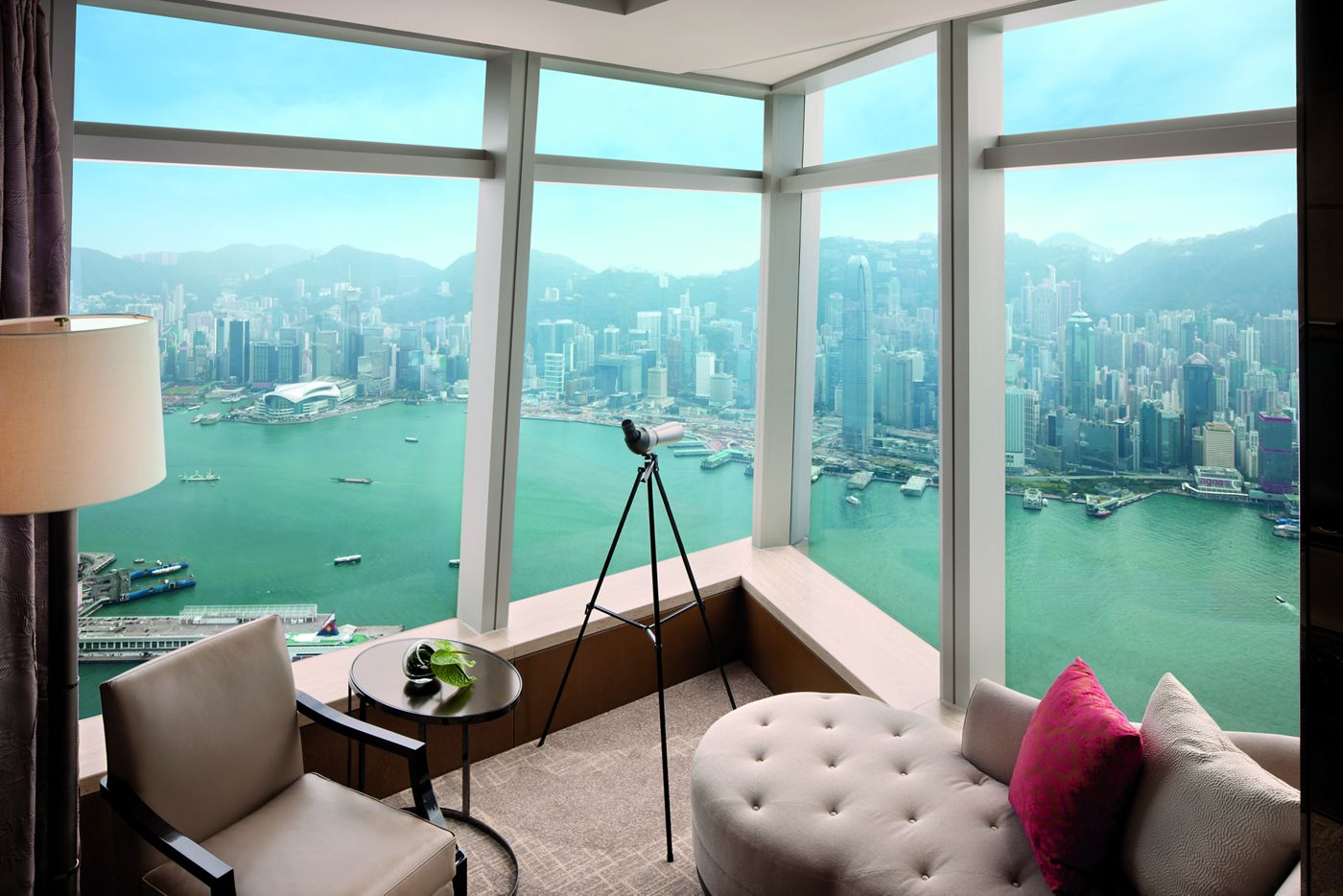 a view of a lake and city skyline from a hotel room at the Ritz Carlton in Hong Kong