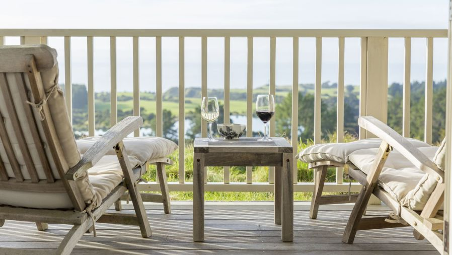 patio furniture overlooking a farm