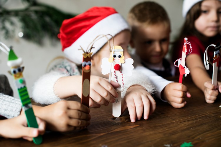 kids with holiday decorated popsicles