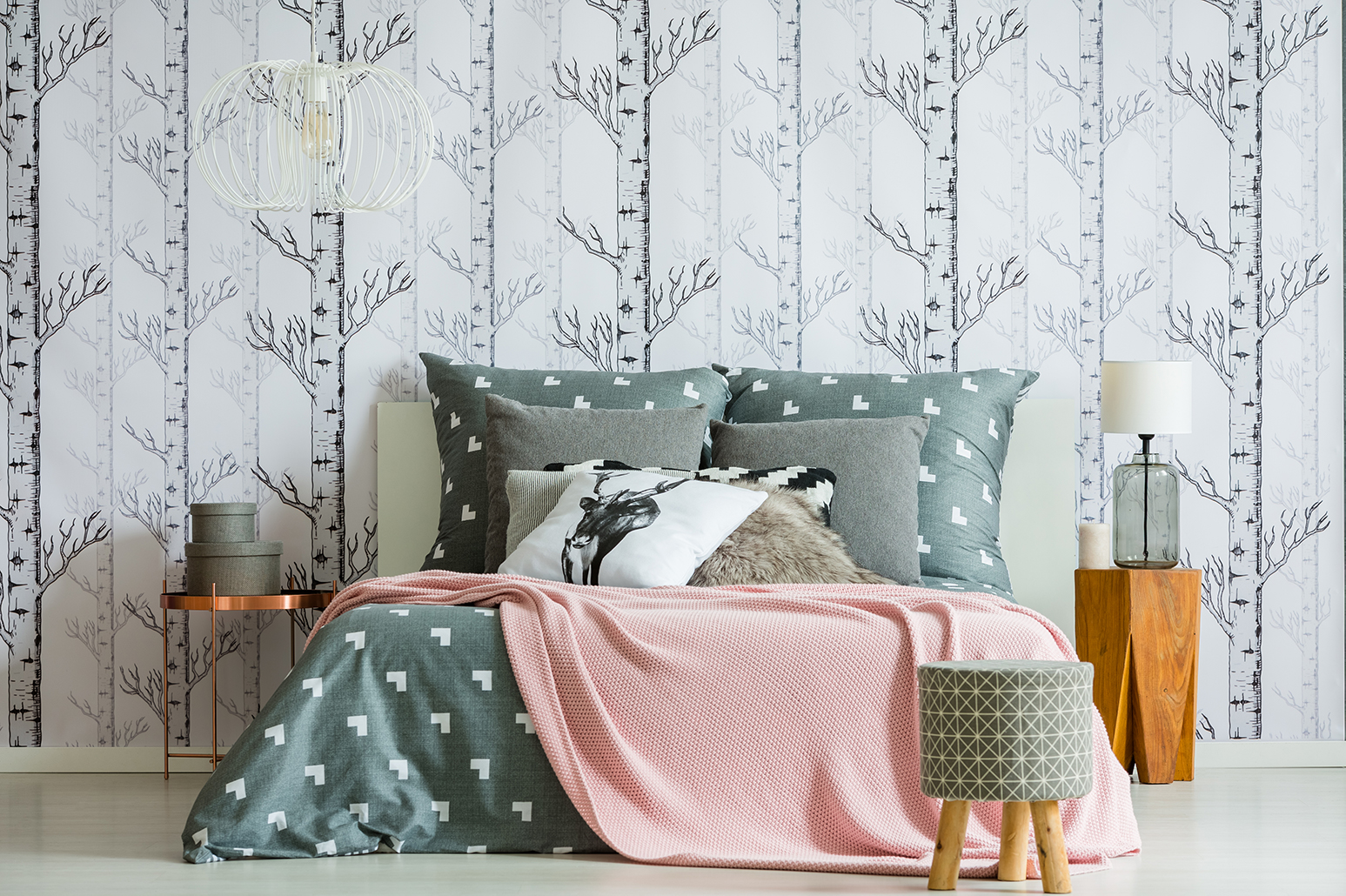 a bedroom with a tree-trunk wallpaper