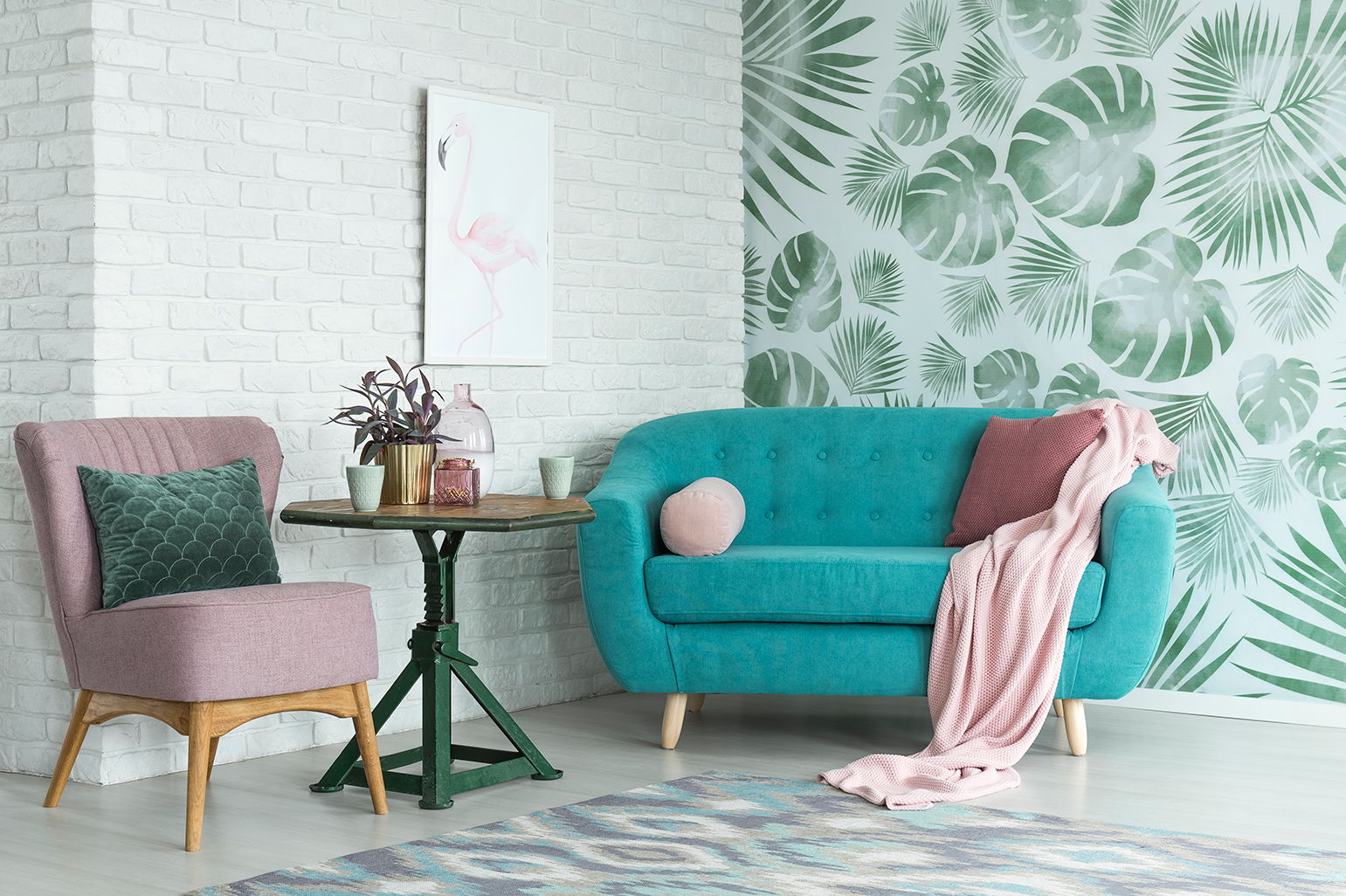 a tropical leaves wallpaper in a living room