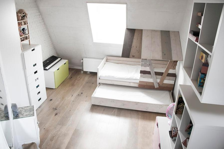 a bedroom with white furnishings
