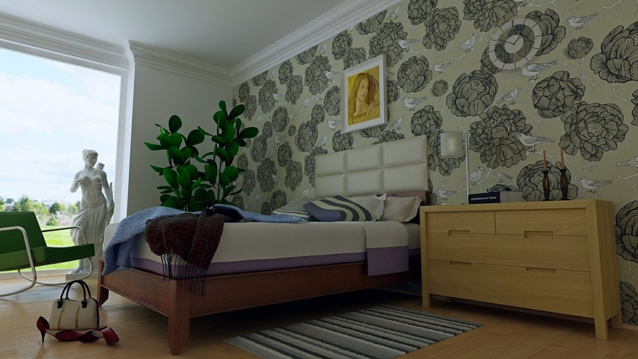 a lettuce and bird-patterned wallpaper in a bedroom