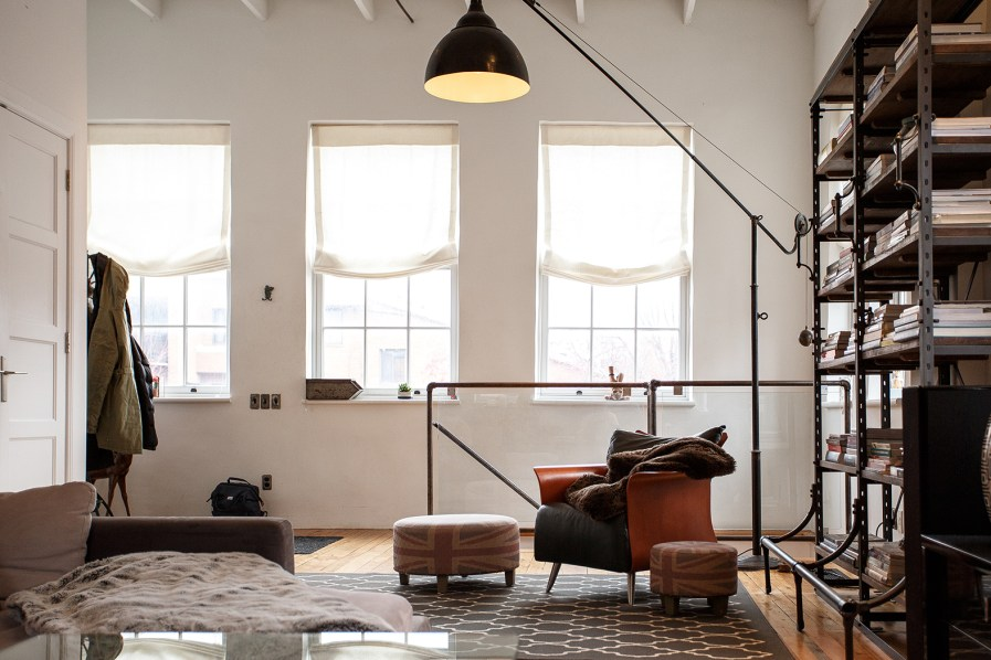 A softly lit second-floor sitting area in a loft space