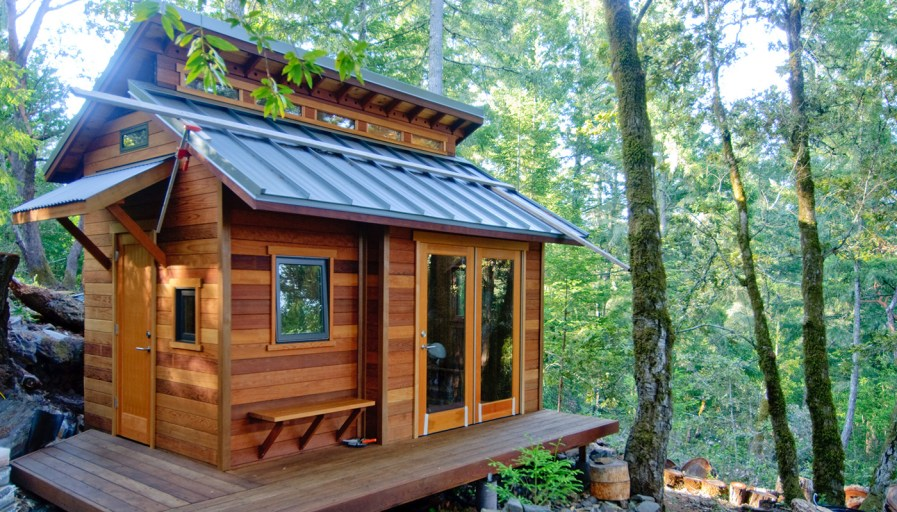 wooden outdoor shed placed in forest