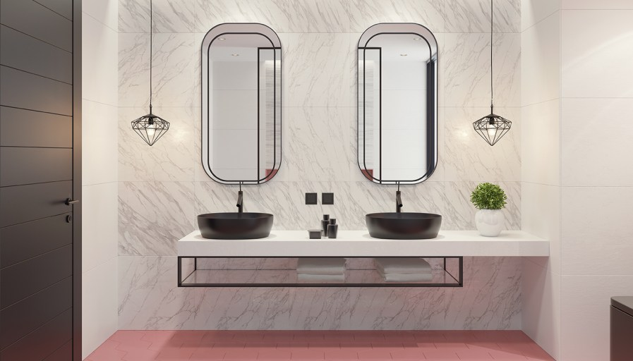 Bathroom with double sink and unique mirrors with black lines accenting them