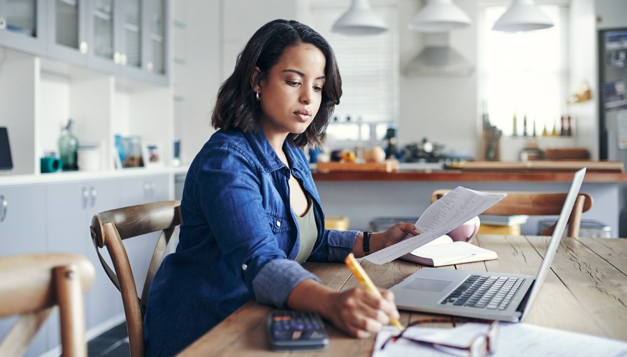 woman at kitchen table doing work