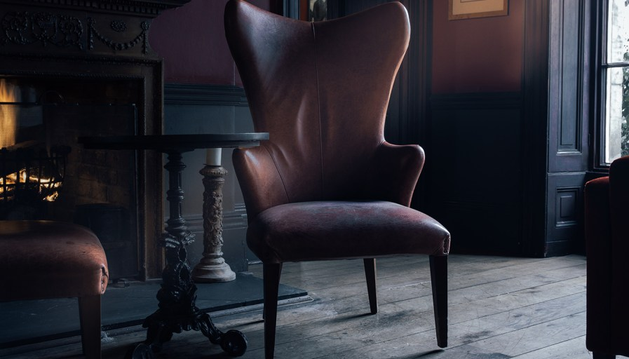 Black leather wingback chair