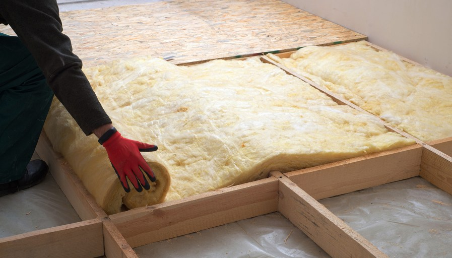 Person laying insulation