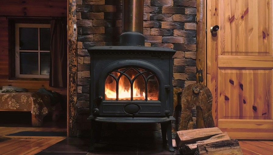 Wood stove in a rustic log cabin