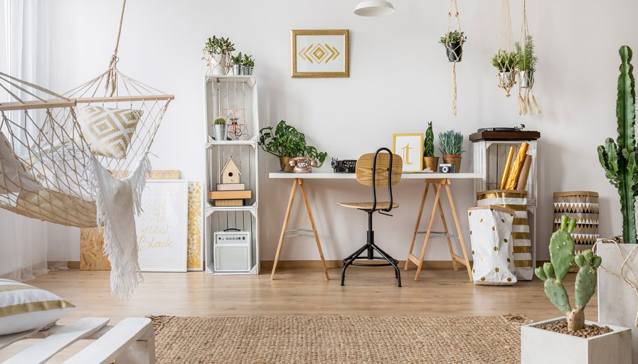 Bohemian office with lots of plants and neutral coloured furniture