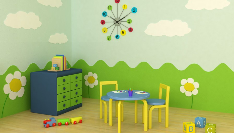 A childs play room with a painted mural on the wall of rolling hills, flowers and clouds.
