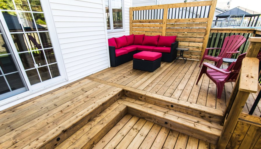 treated wood deck, big enough for a barbecue, a table and chairs
