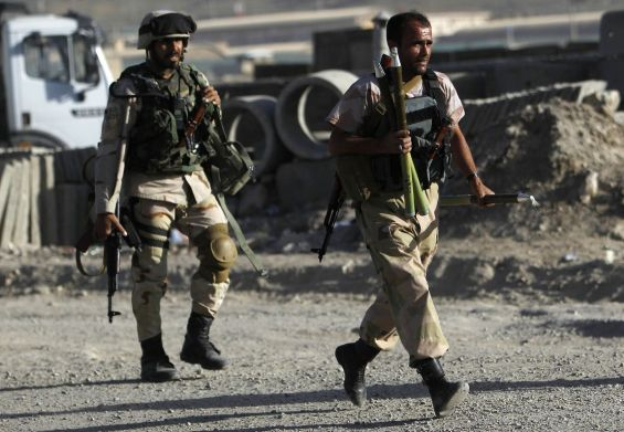 Afghan security forces arrive at the site of an attack in Kabul