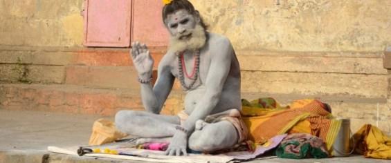 A sadhu performing morning ritual at Dashaswamegh Ghat bank