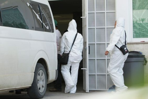 Forensic experts arrive with recovered remains of bodies from six mass graves