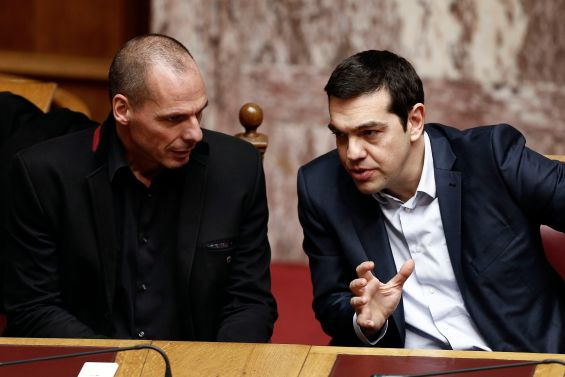 Greek PM Tsipras and Finance Minister Varoufakis talk during the first round of a presidential vote at the Greek parliament in Athens