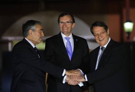 epaselect epa04743819 Special Advisor to the UN Secretary-General on Cyprus, Espen Barth Eide (C), poses with the leaders of Cyprus' two communities, President Nicos Anastasiades (R) and Turkish Cypriot leader Mustafa Akinci (L), after hosting a dinner at Ledra Palace in the UN-patrolled Buffer Zone in Nicosia, Cyprus, 11 May 2015. It is the first time the two leaders met after Akinci was elected leader of the Turkish Cypriots last in April. The Republic of Cyprus has been divided since 1974 when Turkey invaded the island. It still occupies 37 per cent of this EU Mediterranean country, despite repeated calls by international and European organizations to withdraw its troops from the island. UN-backed talks are expected to begin in the coming days with the aim to reunite the island under a federal roof.  EPA/KATIA CHRISTODOULOU