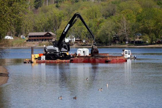 Crews perform dredging work along the upper Hudson River on Thursday, May 7, 2015, in Waterford, N.Y. It is General Electric's  sixth and final season for cleaning up PCBs  discharged into the river decades ago when they were used as coolants in electrical equipment. (AP Photo/Mike Groll)