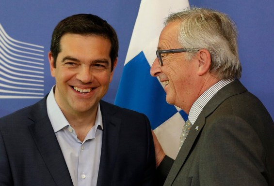 epa04782015 European Commission President Jean-Claude Juncker (R) welcomes Greek Prime Minister Alexis Tsipras (L) prior to a meeting at the EU commission headquarters in Brussels, Belgium, 03 June 2015. Greek Prime Minister Alexis Tsipras meets European Commission President Jean-Claude Juncker in Brussels amid intense media speculation in Athens that a breakthrough is imminent in the country's bailout saga. The head of the Eurogroup of finance ministers, Jeroen Dijsselbloem is also set to join the meeting, underlining hopes that a compromise deal between Athens and its international creditors is taking shape.  EPA/JULIEN WARNAND