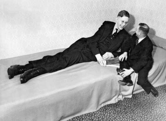Nineteen year old Robert Wadlow of Alton, Illinois, chatting with a friend after appearing at a charity event, Omaha, Nebraska, April 1, 1937. He was eight feet, seven inches tall at the time. (Photo by Underwood Archives/Getty Images)