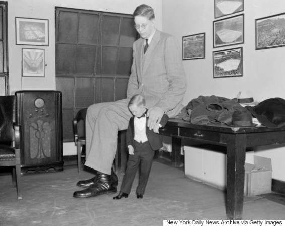 UNITED STATES - CIRCA 2001:  Robert Wadlow, giant at Garden circus, compares size 36 shoes with Major Mite's 4's.  (Photo by Eddie Jackson/NY Daily News Archive via Getty Images)