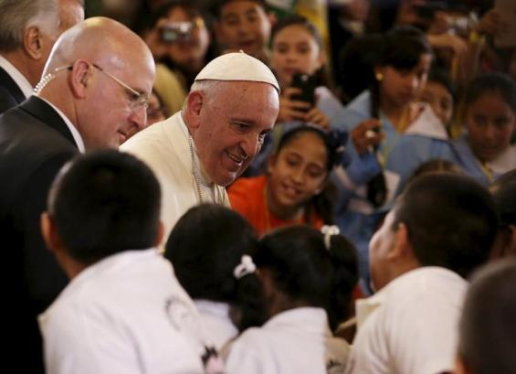 Pope Francis greets children at the cathedral in Morelia