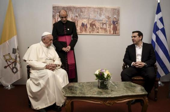 Handout photo of Pope Francis and Greek Prime Minister Alexis Tsipras meeting as Pope Francis visits the Greek Island of Lesbos aiming at supporting refugees and drawing attention to the front line of Europe's migration crisis in Lesbos