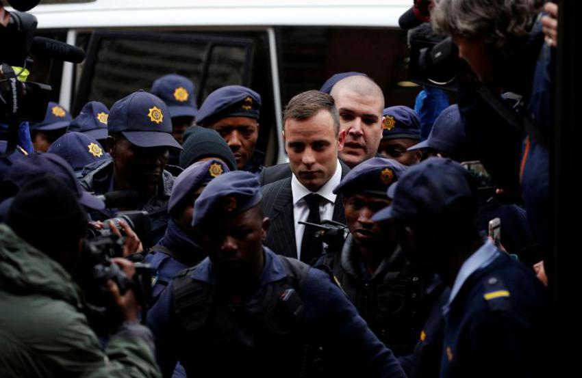Former Paralympian Oscar Pistorius arrives to be sentenced for murder of his girlfriend Reeva Steenkamp, at the Pretoria High Court, South Africa