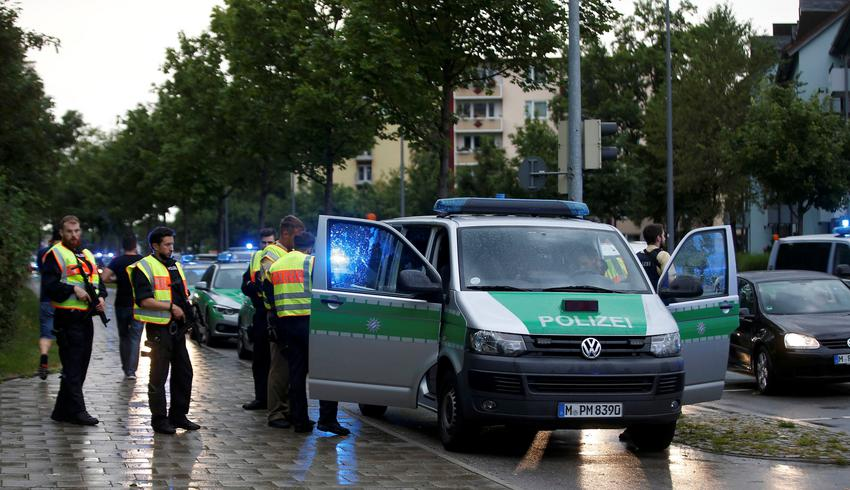 Police secure a street near to the scene of a shooting in Munich