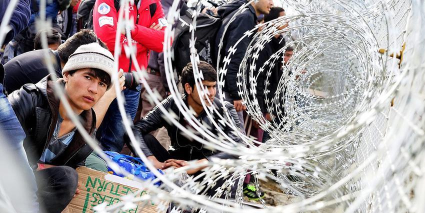 Afghan migrants wait at Macedonia-Greece border