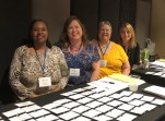 The Registration/Welcome Team: TMF Admin. Asst. Dot Walker; Exec. Admin. Asst. Jennifer Rainwater; Field Coord. Jeanne Breard; Development Coord. Brenda Williams-Denbo